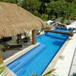 Custom designed Bali style swimming swimming pool with hut and bridge