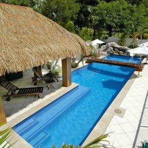 Custom designed Bali style swimming swimming pool with hut and bridge