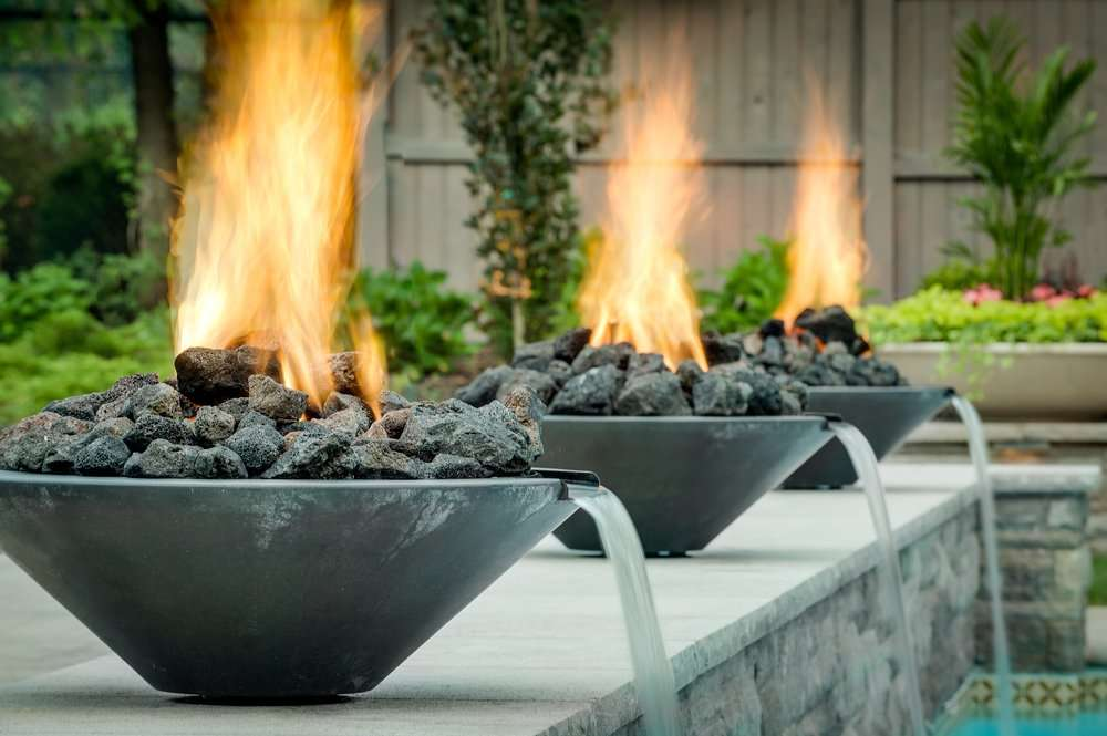 Swimming pool with fire pit and water