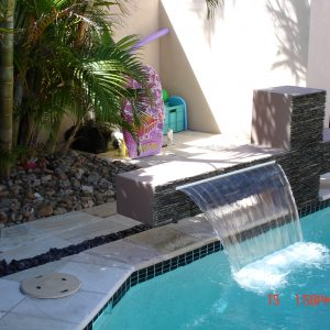 custom style suspended stack stone wster feature by Bali Pool builders