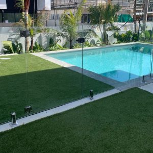 Swimming Pool built by Bali Pools in Kingscliff with landscaping and glass fencing
