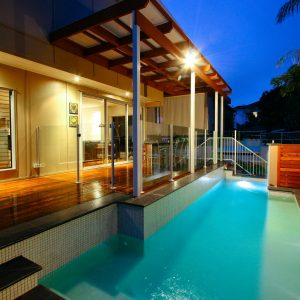 Artistic pool design with a variety of tiled and wooden features