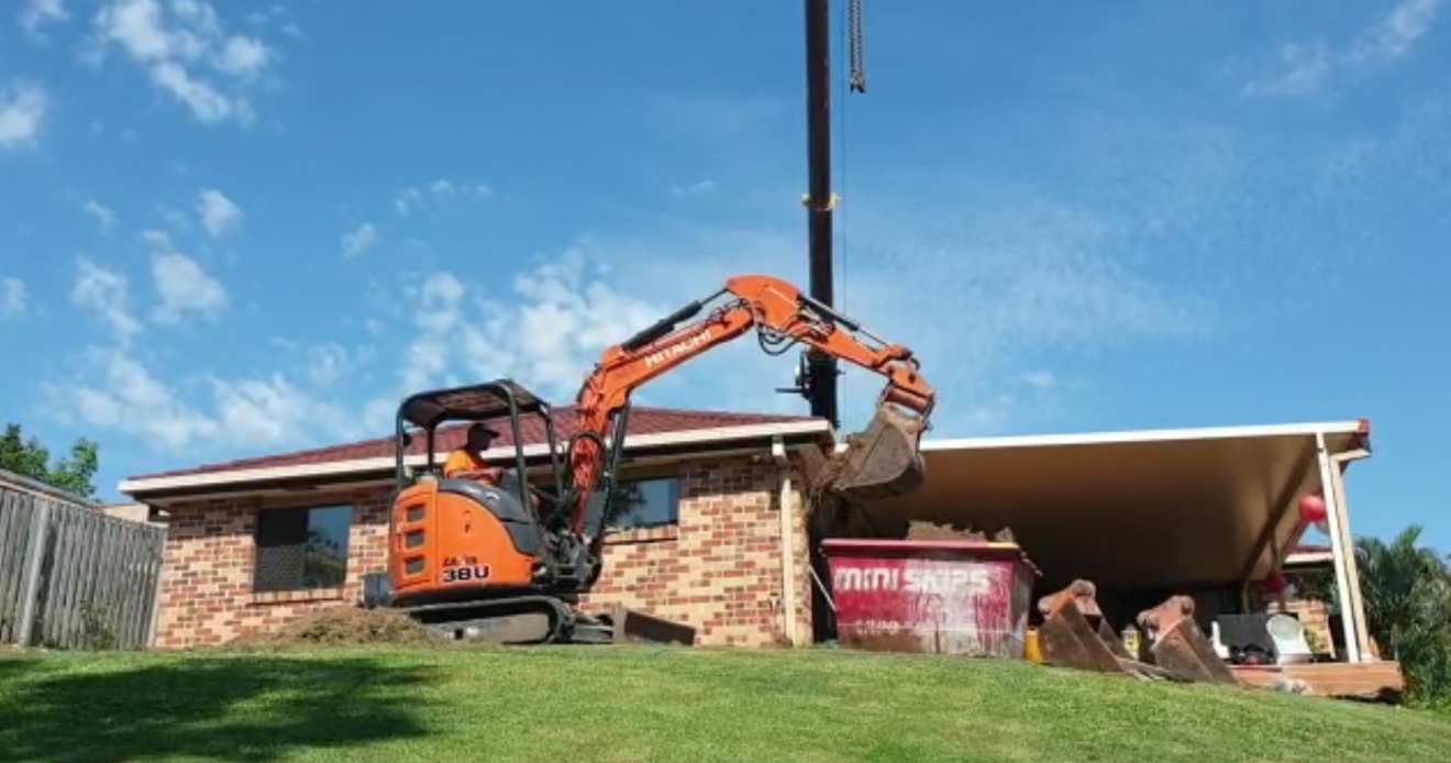 Craned in excavator digging a swimming pool in Elanora on the Gold Coast