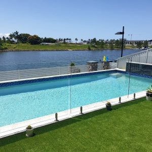artificial turf around swimming pool in Hope Island on the Gold Coast - By Gold Coast pools builders, Bali Pools.