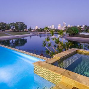 Award winning infinity edge swimming pool with seperate spa built by Bali Pool builders Gold Coast