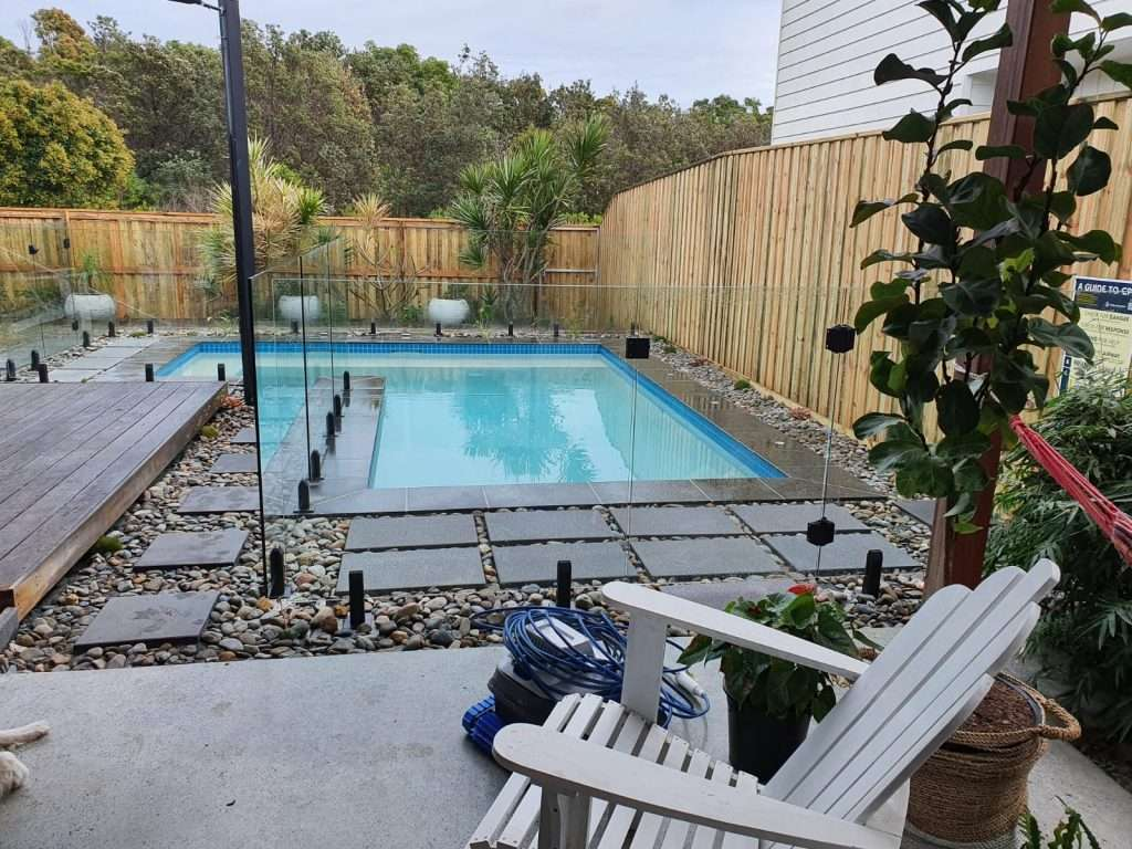 Our team of pool contractors are thrilled to have provided such a unique stunning L shaped pool with frameless glass fencing, stone surrounds, and custom selected pool tiles to compliment the entertainment area. Included are deck jets to for a subtle water feature.
